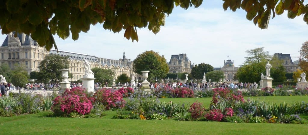 Statues and flowers at Tuileries garden Paris