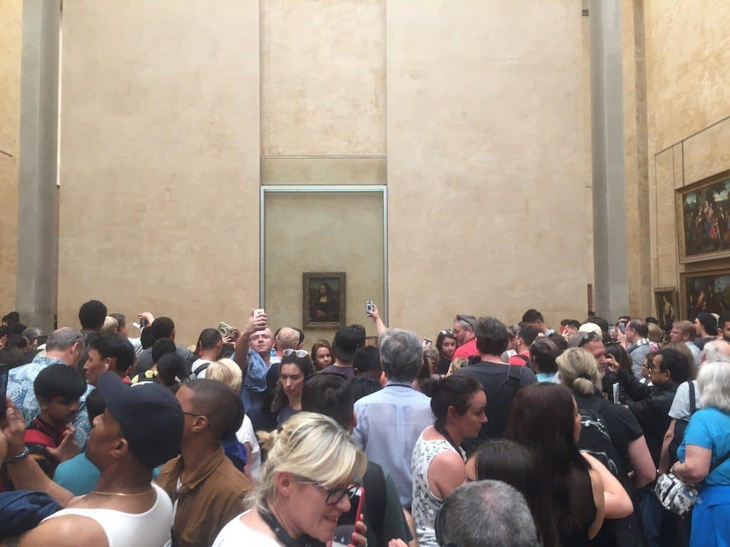 Crowds flock to the Louvre to see the Mona Lisa.